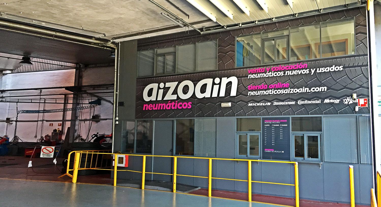 Neumáticos Aizoain - Diseño y Rotulación de fachadas - Curva Rotulación Integral Pamplona